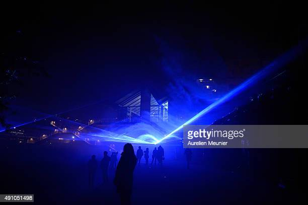 Shadows are seen in the blue light creation by Dutch artist Daan Roosegaard entitled 'Waterlicht' during the 'Nuit Blanche 2015' press review on...