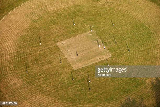 Shadows from the evening sun highlight a team of cricketers as they play a game of cricket in this aerial photograph taken over London UK on Tuesday...