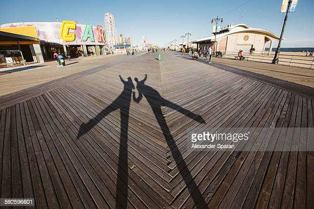 Shadows of 2 persons dancing on Brighton Beach