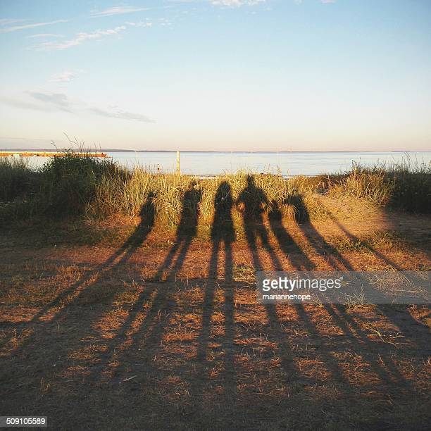 Shadows of a family on the beach, Norway