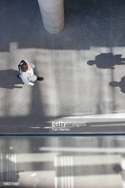 Shadows of businessman walking from directly above