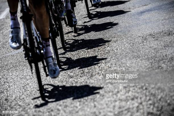 Shadows of cyclists riding are pictured during the 165 km sixteenth stage of the 104th edition of the Tour de France cycling race on July 18 2017...