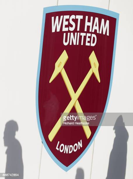 Shadows of fans are seen next to the West Ham crest prior to he Premier League match between West Ham United and Chelsea at London Stadium on...