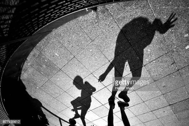 Shadows of kids playing soccer are seen at Moscow downtown on June 18, 2018 in Moscow, Russia.