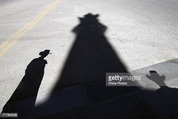 Shadows of monks standing beside a pagoda are seen at the Potala Palace Plaza is seen on September 1 2006 in Lhasa of Tibet Autonomous Region China...