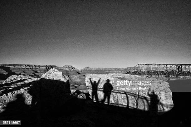 shadows of people on rocks - steve matten stock pictures, royalty-free photos & images