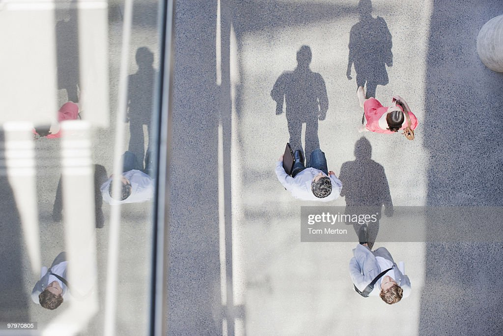 Shadows of people walking from directly above : Stock Photo