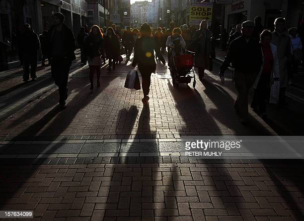 Shadows of shoppers are seen in Grafton Street in Dublin Ireland on November 25 2011 Hammered by austerity measures a year after receiving a massive...