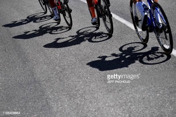 Shadows of the riders of the breakaway are casted on the asphalt during the eighth stage of the 106th edition of the Tour de France cycling race...