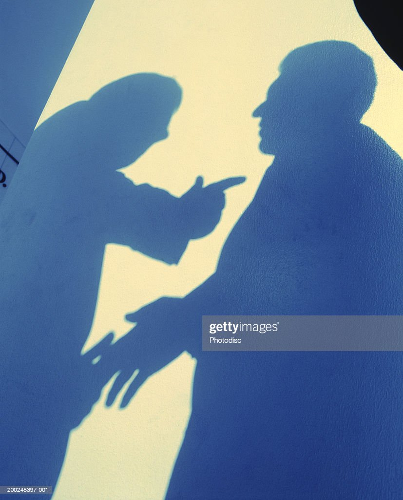 Shadows of two men arguing, (Low angle view) : Stock Photo