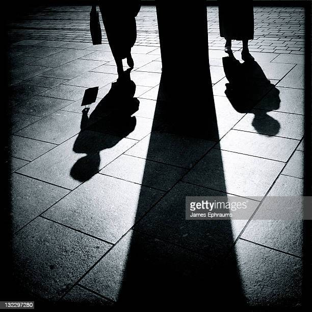 shadows of two women - parallel stock pictures, royalty-free photos & images