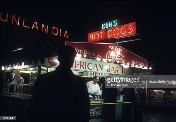 A shadowy customer approaches Ken's Hot Dogs stand in Blackpool