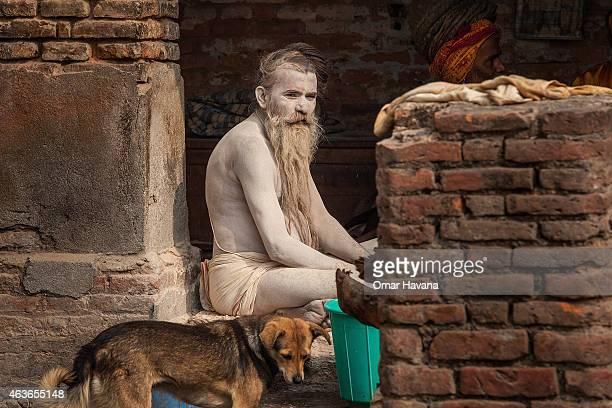 Shadu or holy man sits inside Pashupatinath temple during the celebration of the Maha Shivaratri festival on February 17 2015 in Kathmandu Nepal...