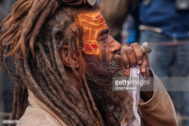 Shadu or holy man smokes cannabis from a chillum inside Pashupatinath temple during the celebration of the Maha Shivaratri festival on February 17...