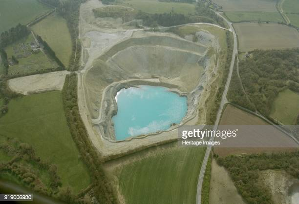 Shadwell Quarry near Much Wenlock Shropshire 2002 The basin of the quarry has filled with water and the limestone quarried here has helped to give...