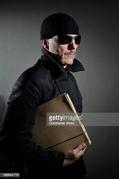 shady character with secrets - con man stock photos and pictures