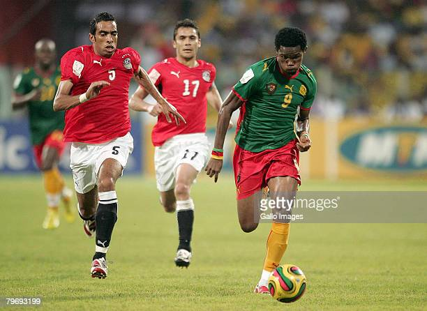 Shady Fattah Mohamed and Ahmed Hasan Kamel of Egypt run after and Samel Eto'o of Cameroon during the AFCON match final between Cameroon and Egypt...