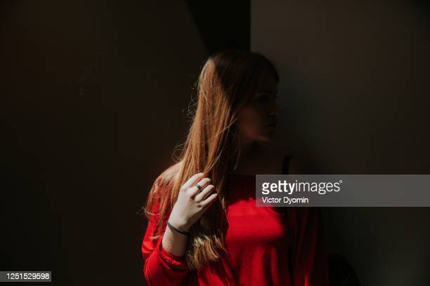 shady portrait of the young redhead woman - obscured face stock pictures, royalty-free photos & images