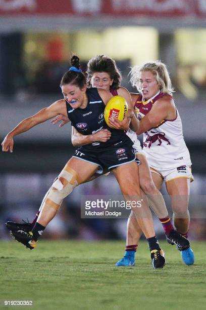 Shae Audley of the Blues is tackled by Nat Exon of the Lions during the round three AFLW match between the Carlton Blues and the Brisbane Lions at...