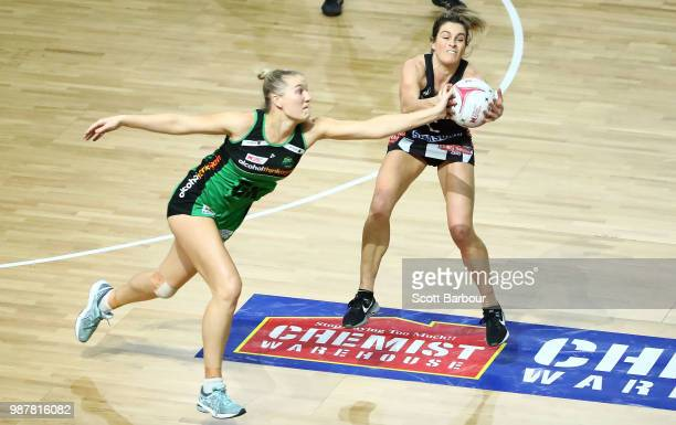 Shae Brown of the Magpies and Courtney Bruce of the Fever compete for the ball during the round nine Super Netball match between the Magpies and the...