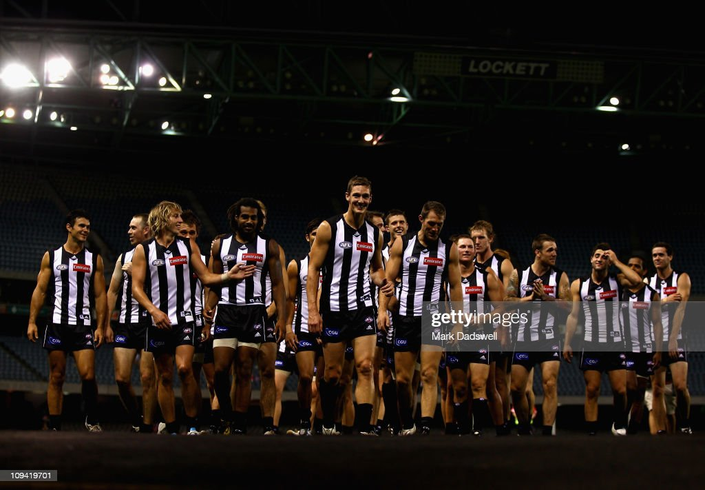 Shae McNamara of the Magpies leads the team off after the clubs win in the NAB Cup Quarter Final match between the Collingwood Magpies and the Sydney Swans at Etihad Stadium on February 25, 2011 in Melbourne, Australia.