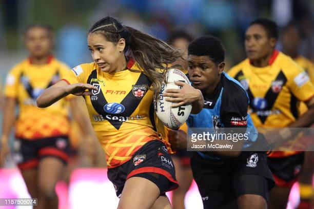 Shae Yvonne Dela-Cruz of PNG runs the ball during the Women's Pacific International Test Match between Fijji and Papua New Guinea at Leichhardt Oval...