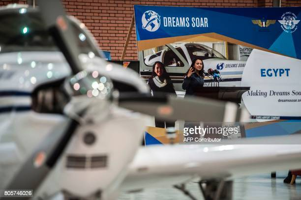 Shaesta Waiz Afghanistans first female certified civilian pilot gives a speech in a hangar at Cairo International Airport on July 2 2017 during her...