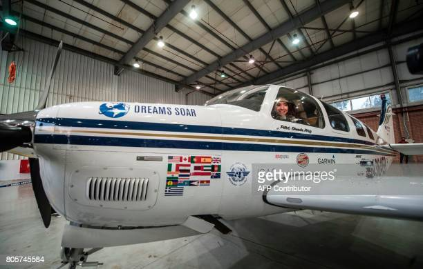 Shaesta Waiz Afghanistans first female certified civilian pilot poses for a picture from inside her plane in a hangar at Cairo International Airport...