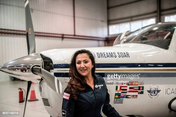Shaesta Waiz Afghanistans first female certified civilian pilot poses for a picture from inside her plane at Cairo International Airport on July 2...