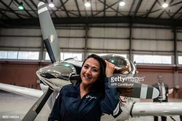 Shaesta Waiz Afghanistans first female certified civilian pilot poses for a picture by her plane in a hangar at Cairo International Airport on July 2...