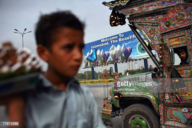 Shafik sells coconut pieces to motorists near a new police check point on November 4 2007 at the entrance to Islamabad Pakistan On Saturday the...