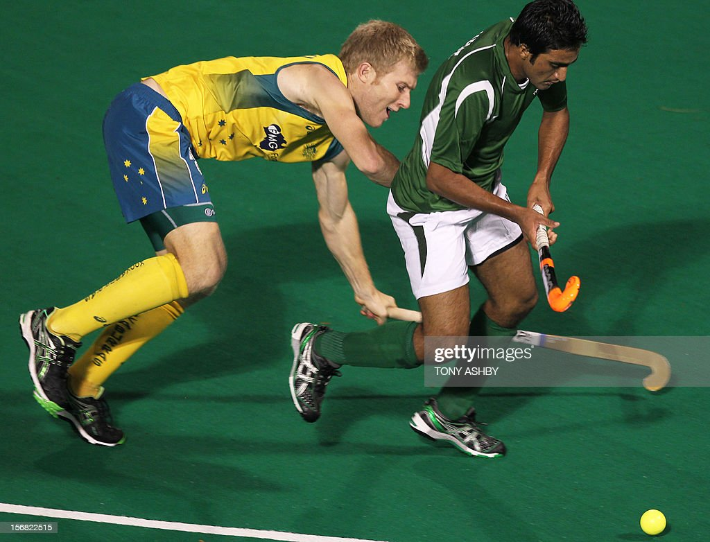 Shafqat Rasool of Pakistan (R) is tackled by Matthew Butturini of Australia during their men's match at the International Super Series hockey tournament in Perth on November 22, 2012.