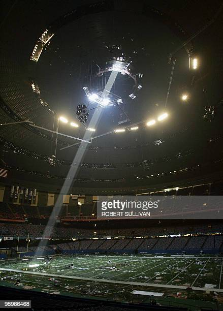 A shaft of light falls throught an opening in the fully evacuated Superdome 05 September 2005 in New Orleans LA The complete evacuation of New...