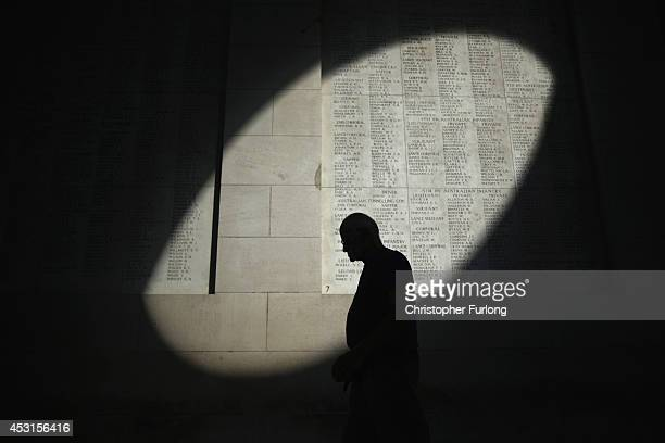 Shaft of sunlight falls on the names of the missing at the Menin Gate Memorial on the centenary of the Great War on August 4, 2014 in Ypres, Belgium....