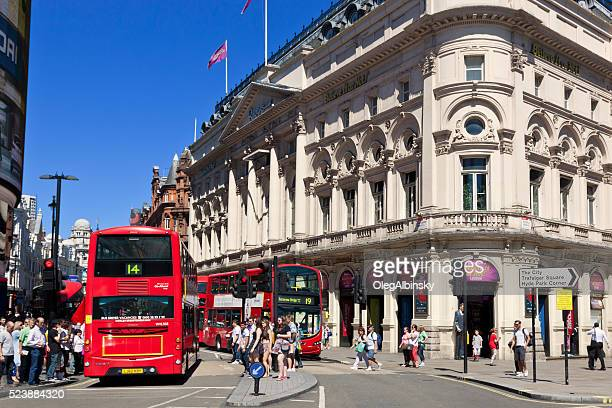 shaftesbury avenue with red double decker bus and tourists, london. - shaftesbury avenue london stock photos and pictures