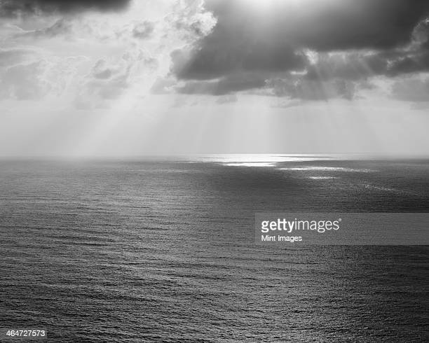 shafts of sunlight shining through cloud and a view over the pacific ocean, at manzanita, oregon. - manzanita stock pictures, royalty-free photos & images
