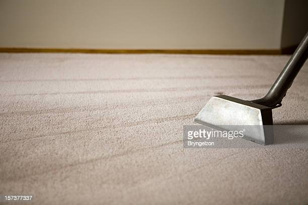 shag rug with carpet cleaning equipment - tapijt stockfoto's en -beelden