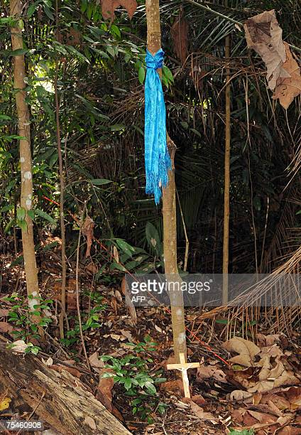 A crucifix lies at the crime scene in the forest where prosecutors allege Mongolian Altantuya Shaariibuu was murdered in Shah Alam near Kuala Lumpur...