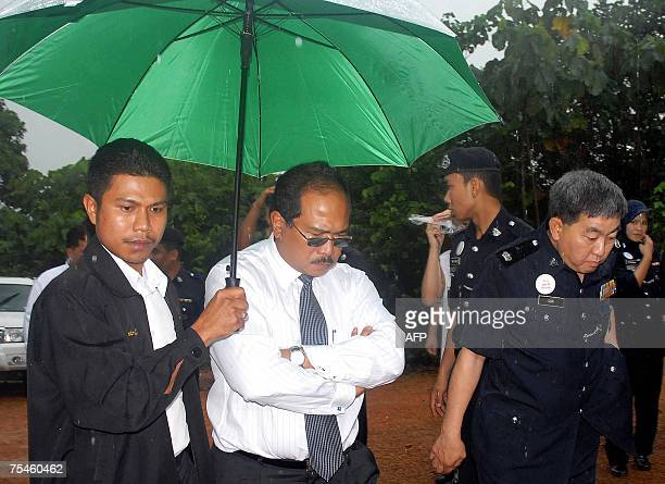 Judge Mohammed Zaki Mohammed Yasin arrives in the forest where prosecutors allege Mongolian Altantuya Shaariibuu was murdered in Shah Alam near Kuala...