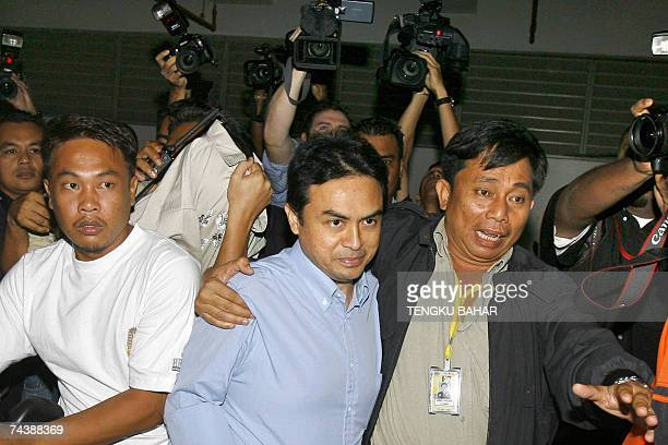 Political analyst Abdul Razak Baginda charged for abetting the murder of 28year old Mongolian Altantuya Shaariibuu is escorted past a pack of news...