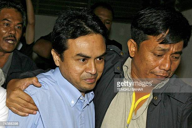 Political analyst Abdul Razak Baginda charged for abetting the murder of 28year old Mongolian Altantuya Shaariibuu is escorted into the high court in...