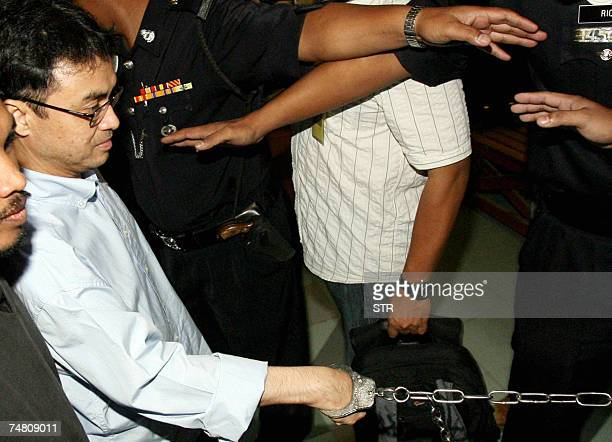 Political analyst Abdul Razak Baginda charged with abetting the murder of his former Mongolian lover Altantuya Shaariibuu is led to the courtroom...