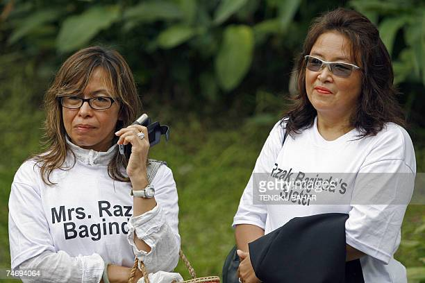 Wife of charged political analyst Abdul Razak Baginda Mazlinda Makhzan and his sister Rohannie Abdullah Baginda wear tshirts proclaiming their...
