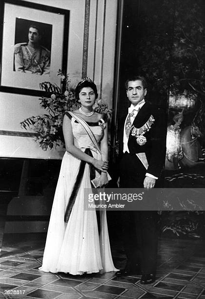 Shah Mohammad Reza Pahlavi of Persia with his wife Queen Soraya after arriving in England for an informal visit Original Publication Picture Post...