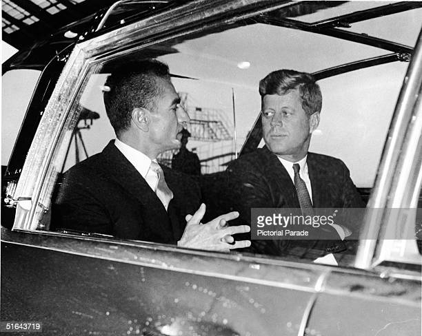 Shah Mohammed Reza Pahlavi of Iran sits and talks with American president John F Kennedy in the back of the president's custom 'bubbletop' Lincoln...