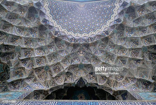 'Shah Mosque 16121638 17th Century mixed technique Iran Isfahan Detail The entrance of the mosque is characterized by a vault built with the muqarnas...