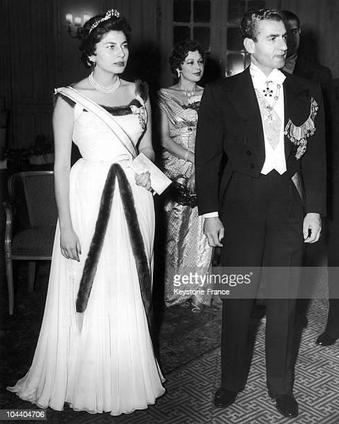 Shah Muhammad Reza PAHLAVI of Iran and empress SORAYA at a reception given by the Iranian ambassador in England, Ali SOHEILY in London Savoy Hotel.