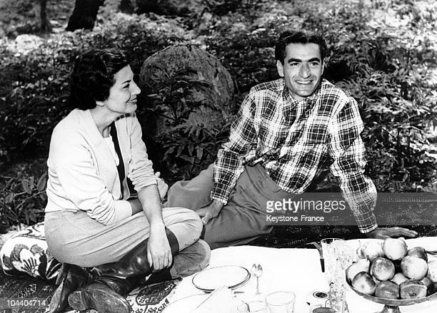 Shah Muhammad Reza PAHLAVI of Iran and his wife Empress SORAYA photographed during their vacation on the coast of the Caspian Sea, near Baghdad. The...