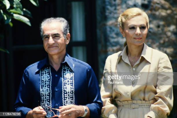Shah of Iran and his now widow Farah Pahlavi after they left Iran in exile pose outside a mansion June 14 1979 Cuernavaca Mexico