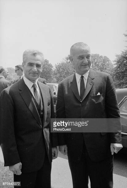 Shah of Iran Mohammad Reza Pahlavi poses with US President Lyndon B Johnson outside the White House Washington DC June 5 1964